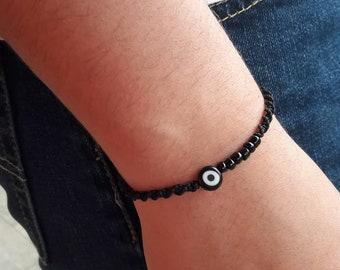 """Black evil eye bracelet """"strength"""" , 8 mm Eye"""
