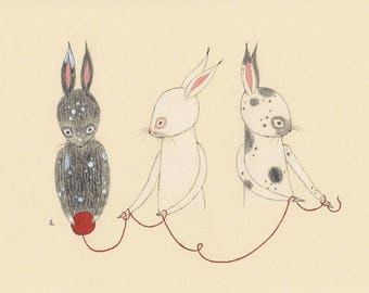 Bunnies with red yarn