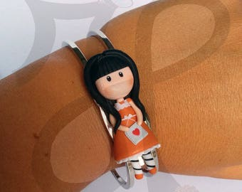 Metal bracelet with baby doll