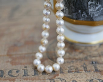 Vintage Glass Pearl Strand 14 inches long Cream Luster Color Pearls 6mm Knotted Pearls with Long Silk Cords Ends (1 Strand) DA6