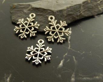 4 silver metal snowflake charms