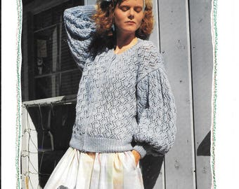Original knitting pattern for a ladies round neck cardigan using double knit wool and to fit sizes 30 - 44 ins / 76 - 112 cms