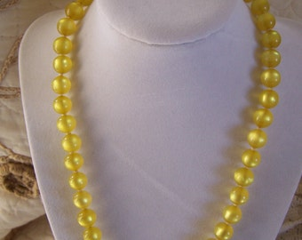 "Vintage 50's Lucite  ""MOON GLOW BEADS Necklace"" in a Yellow / Golden Color"