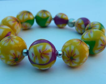 Elastic bracelet round beads multicolor flowers joyful