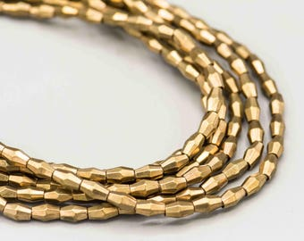 """Brass Faceted Bicone Beads 7x4mm 80 Beads on 22"""" Strand MFB-B-234"""