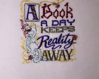 A Book A Day Keeps Reality Away - Embroidered Towel (terry cloth or flour sack)