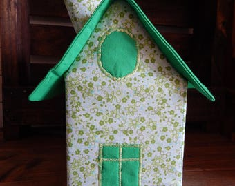House with handkerchiefs in plain green roof and green flowers