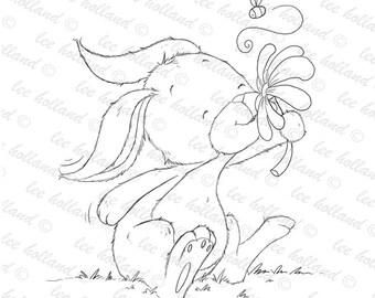Bunny smelling flower