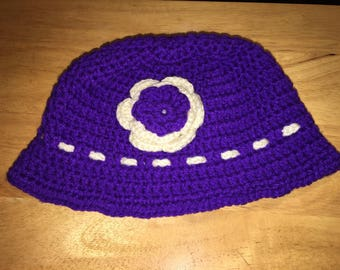 Purple hat with Purple and soft white attached flower