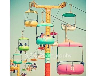Carnival Photo. Santa Cruz Beach Boardwak. Skygliders. Colorful. Retro. vintage. Bright. Pink. Blue. yellow. green. people. happy. summer.