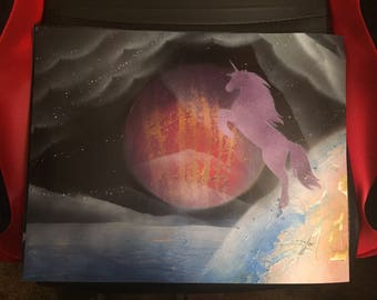 Spray paint art with unicorn, planet, sky and ground.