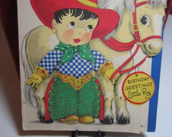 Adorable 1930's-40's die cut birthday card for little boy sweet faced boy in cowboy outfit and pony tiny beads on boys chaps and gloves
