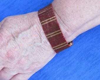 Raspberry metallic with gold stripes seed bead loomed bracelet