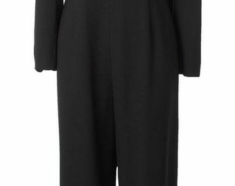 Black Jumpsuit with White Piping And Cropped Jacket.