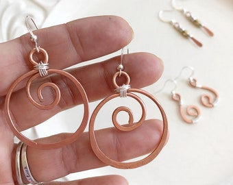 Hand forged copper earrings with sterling silver wire accents and the smaller pair has a added silver and gold color bead accents!