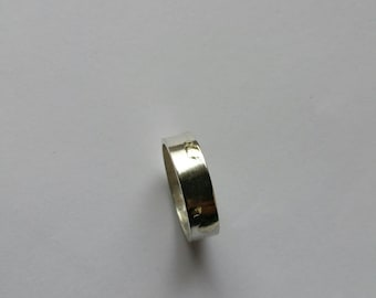 Mixed ring and small mounds of melted gold ring. Sterling Silver ring. Handcrafted and unique