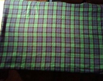 Plaid flannel baby blanket.