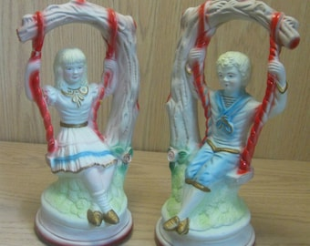 Ceramic Pair Boy & Girl Each On A Swing Hand Painted 1950's