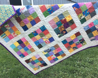 Bright and cheerful modern lap quilt