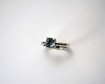 Topaz (6mm) mounted on sterling silver ring