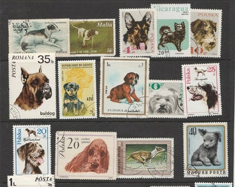 Thematic Dogs used postage stamps off paper for collectors or craftsfolk for use in collage, decoupage and many other uses Active Photos
