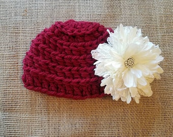 Crochet red baby beanie with large white flower