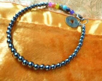 """The 7 chakras"" zen bracelet with hematite gemstones."