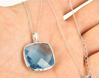 Solid sterling  silver blue topaz necklace pendant