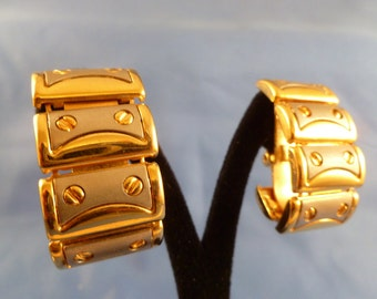 Silver and gold clip earrings