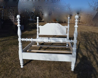 Full vintage white bed. Beautiful thick turns. solid wood .poster bed