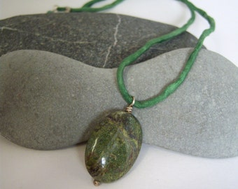 Dragonblood Jasper Oval Pendant Strung on Hand-Dyed Green Silk Cord With Sterling Silver Clasp