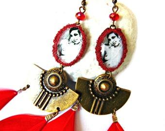 Josephine Baker earrings on red feather