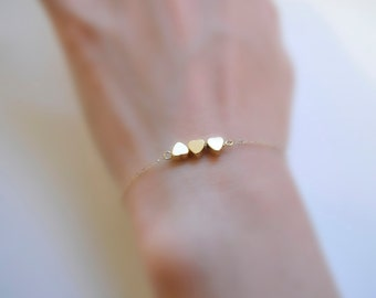 Je T ' aime Three Sisters (bracelet) - Three tiny 14k gold plated puffed hearts and 14k Gold Filled chain