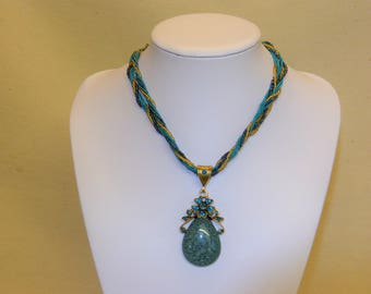 Large Stone Greeny-blue Pendant on twisted bead/cord rope (stock #6638)