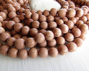 carved Rosewood round wood beads  , pink wood, natural exotic supplies  from Philippines  11 to 12mm  ( 35 beads ) 6ph21