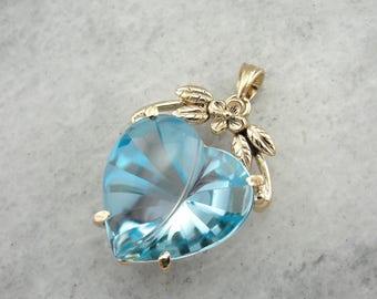 Fantasy Cut Blue Topaz Heart Pendant with Flower Top 84NM24-P