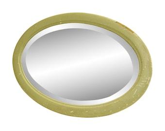 Very worn green oval vintage mirror