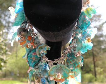 Unique and Different Chunky Charm Bracelet with real Turquoise Beads.