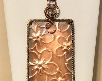 Copper flower embossed pendant, wire wrapped wrapped tag pendant