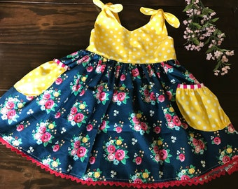 June dress - navy floral and yellow polka dot knotted shoulder sleeve dress with scoop back and polka dot pockets