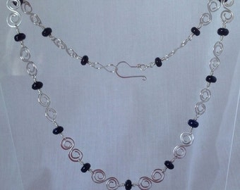 Silver and goldstone necklace