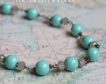 """19"""" Turquoise Pearl and Smoky Crystal Antiqued Brass Wire Wrapped Necklace"""