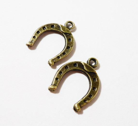 Bronze horseshoe charms 15x12mm antique brass horseshoe pendants bronze horseshoe charms 15x12mm antique brass horseshoe pendants western charms cowgirl cowboy charms horse shoe charm metal charms 10pcs from aloadofball Image collections
