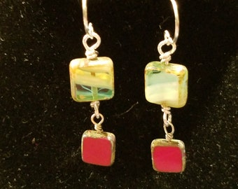 Dangle earrings featuring deep red and blue-green Czech glass  on silver ear wires