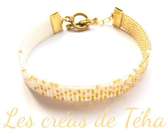 Lovely gold and white bracelet woven with miyuki beads