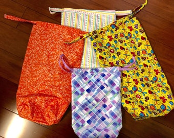 "Bathing suit bag / shoe bag / waterproof bag NO longer available purple but 4"" x 7 1/2"" x 18"" stripes, orange or yellow"