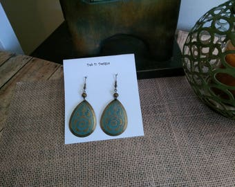 Turquoise and antique gold embossed dangle