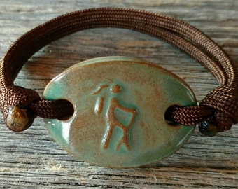 Girl Hiker in Turtle Shell with Adjustable Paracord Bracelet