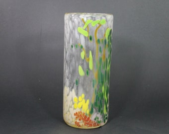 Handblown glass cylinder vase with green leaves and yellow flower