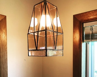 Light pink geometric hanging lamp